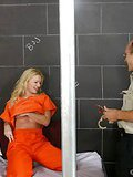 Female jail bird gives footjob to the guard