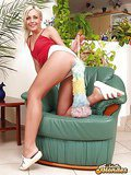 Platinum blonde goddess fingering her wet snatch on an armchair