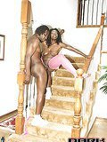 Curly haired black bitch in pink fishnets jumps a huge dick on the stairs