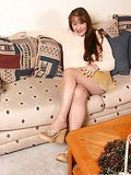 Auburn haired cute slave Candi gets tied up on the couch