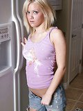 Salacious blonde teen Dani Wild stripping seductively in the kitchen