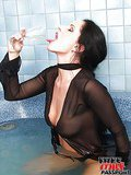 Excited brunette milf masturbating with a champagne bottle and a huge dildo in the bathroom